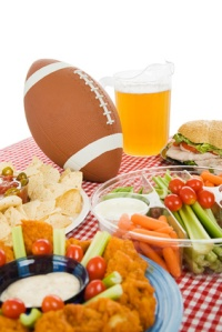 Table set with snack foods for a Super Bowl party, over white
